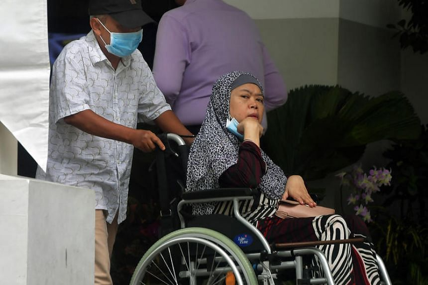 Zariah Mohd Ali and her husband Mohamad Dahlan leaving the State Courts on July 30, 2019.