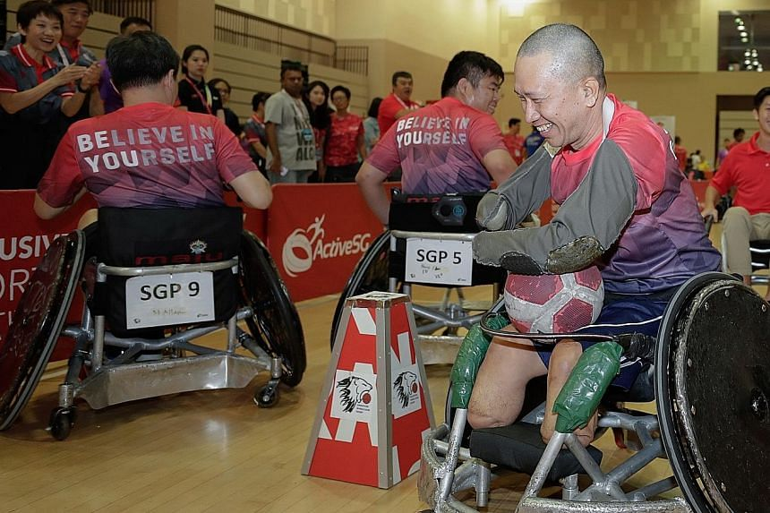 Tan Whee Boon, 54, trying out different sports at the Inclusive Sports Festival at Our Tampines Hub yesterday. Minister for Culture, Community and Youth Grace Fu believes that everyone should have access to sport, regardless of whether one has specia