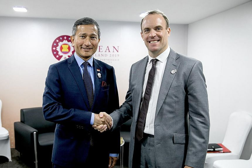 Singapore Foreign Minister Vivian Balakrishnan meeting British Foreign Secretary Dominic Raab on the sidelines of the Asean Foreign Ministers' Meeting in Bangkok yesterday. Dr Balakrishnan congratulated Mr Raab on his appointment to the post last wee