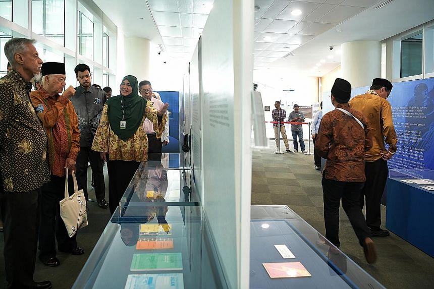 Guests touring the Treasures Of Muslim Scholars: 100 Years Of Singapore Literary Heritage exhibition, which was launched at the National Library Building yesterday.