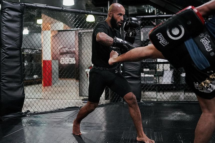 Mixed martial arts fighter Demetrious Johnson training inside a cage ahead of One's Dawn of Heroes event in Manila today. He will take on Japan's Tatsumitsu Wada in the semi-final of the grand prix tournament.
