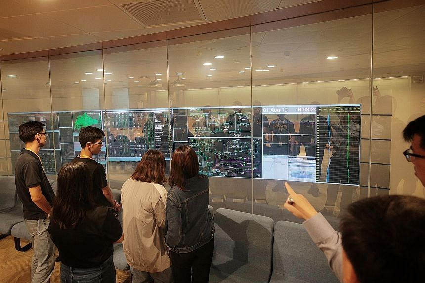 Polytechnic students in the viewing gallery of the Energy Market Authority's Power System Control Centre yesterday.
