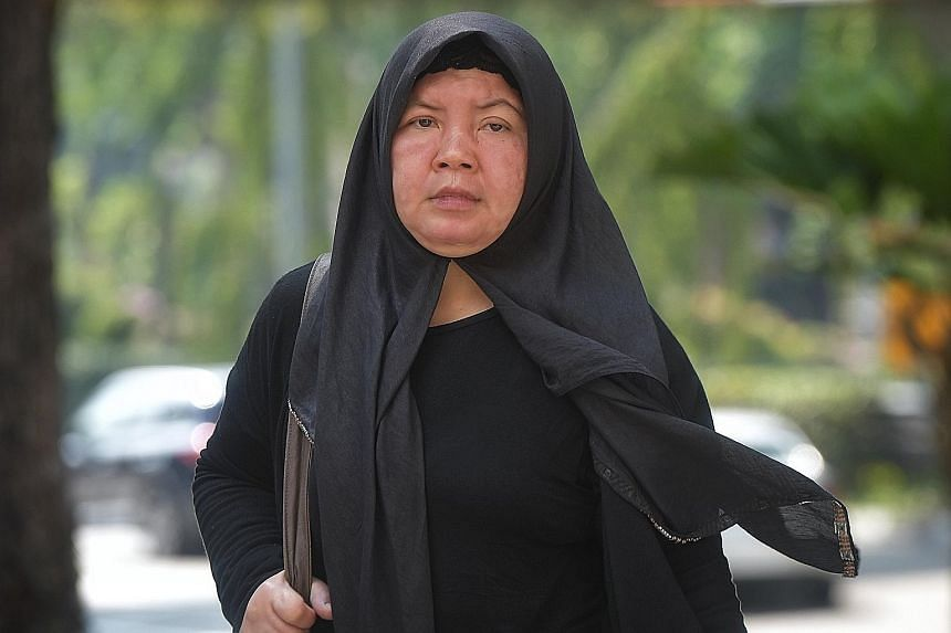 Ms Khanifah (above), a mother of two, suffered permanent disfiguration, including a deformed left ear and scars on her forehead, among other injuries. The prosecution called the abuse inflicted on her by Zariah Mohd Ali (left), 58, and her husband Mo