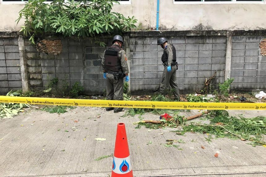 Bomb squad inspecting the Rama 9 Road site. The bomb found there appeared to be a homemade bomb which police said injured at least two street sweepers.