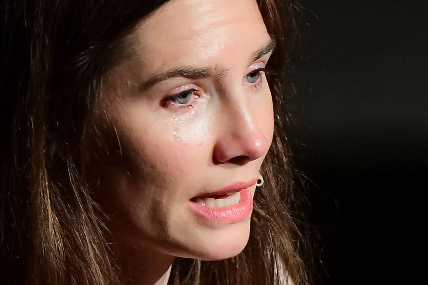 """Knox cries as she addresses a panel discussion entitled """"Trial by Media"""" in Italy in June 2019."""