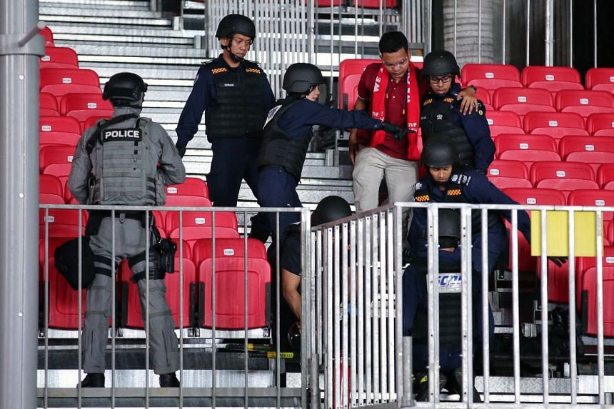 SCDF officers performing rescue operations in the spectator stand during a counter-terrorism exercise demonstration at the Padang, on Aug 2, 2019.