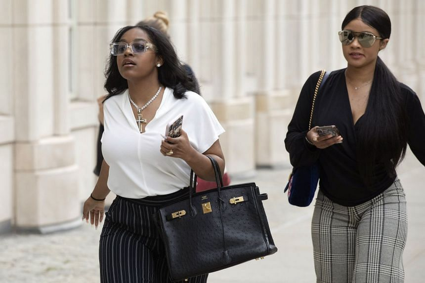 Azriel Clary (left) and Joycelyn Savage, two women who lived in Chicago with R. Kelly, arrive at court for his arraignment.