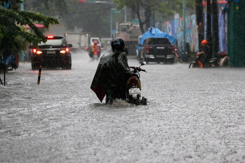 The Supreme Court suspended work in all courts in Metro Manila, while the majority of city mayors ordered students to go home as monsoon rains flooded low-lying areas.