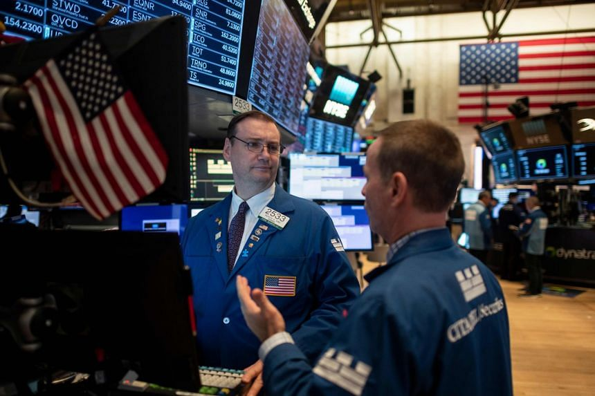 Traders work after the opening bell at the New York Stock Exchange.