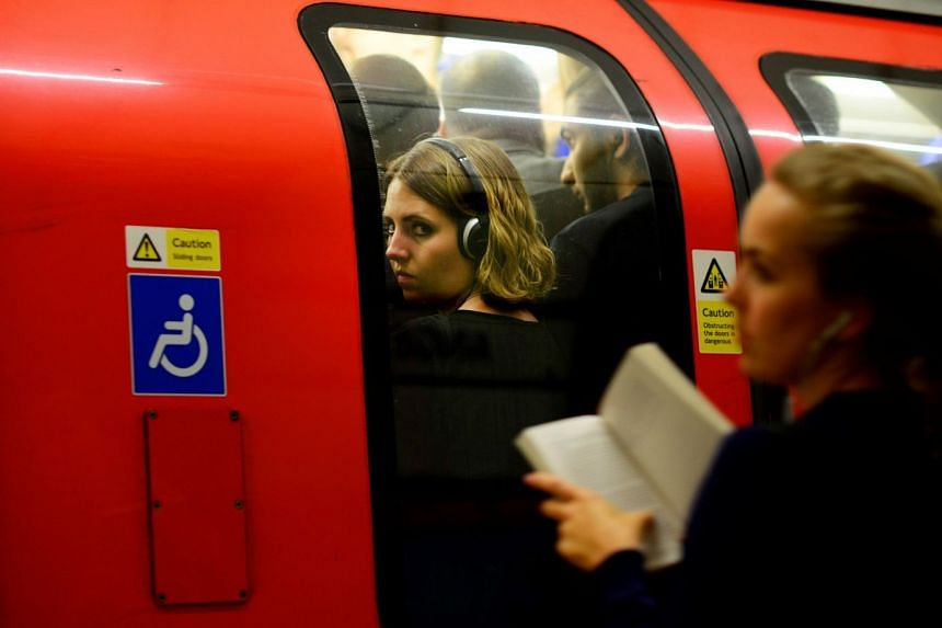 Commuters during rush hour on the London underground in London.