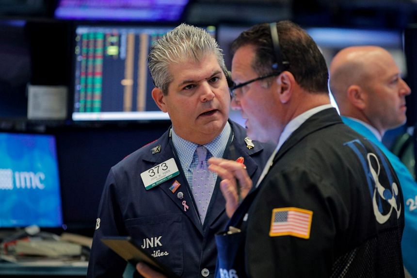 Traders work on the floor at the New York Stock Exchange, Aug 2, 2019.