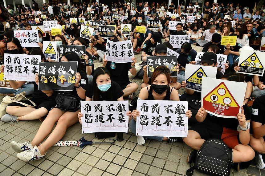 Medical professionals protesting at Edinburgh Place in Hong Kong yesterday. ST PHOTO: CHONG JUN LIANG