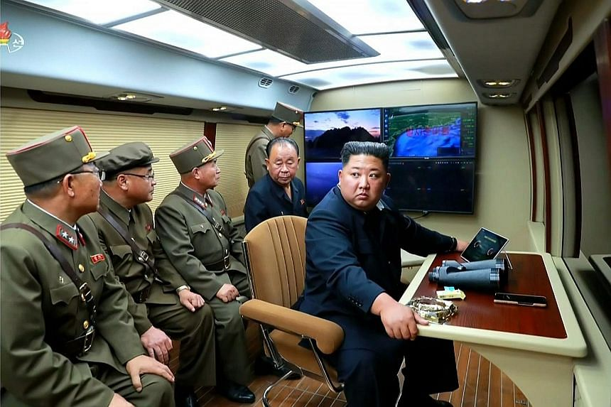 A screengrab taken from North Korean broadcaster KCTV showing the country's leader Kim Jong Un supervising a ballistic missile launch at an unknown location on July 31.