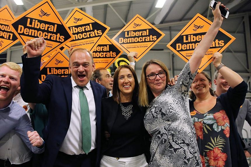 Liberal Democrat candidate Jane Dodds (centre) celebrating with Liberal Democrat MP Ed Davey and her team after winning the Brecon and Radnorshire by-election yesterday. Her victory reduces British Prime Minister Boris Johnson's working majority in P
