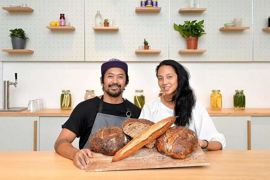 Starter Lab founders Emerson Manibo (left) and Min Siah at their bakery's first overseas outpost in Havelock Road, which seats 35 diners.