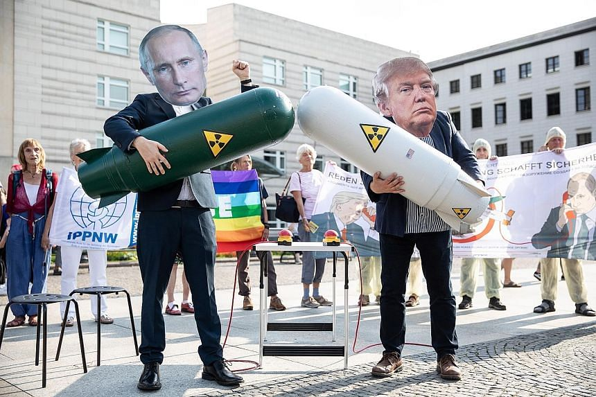 Activists with mock nuclear missiles during a rally against the ending of the 1987 Intermediate-Range Nuclear Forces Treaty outside the US embassy at Pariser Platz in Berlin, Germany, on Thursday.