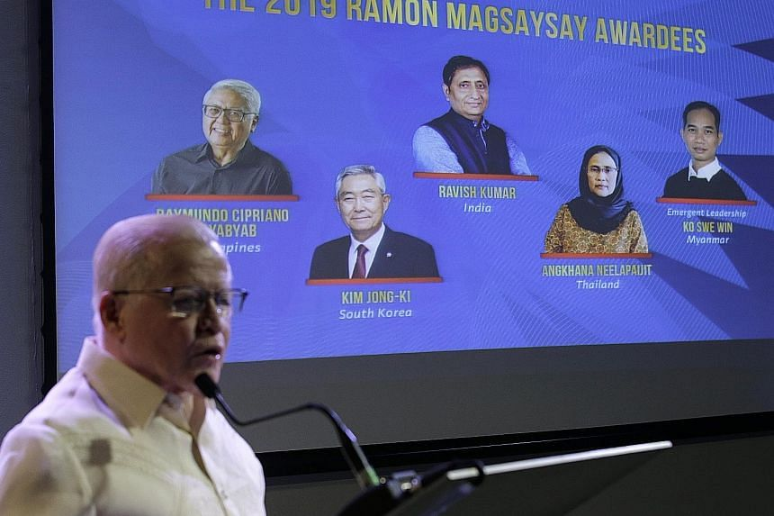 Mr Jose Cuisia Jr, chairman of the award foundation, unveiling the five winners of the Ramon Magsaysay Award during an event in Manila yesterday. PHOTO: ASSOCIATED PRESS