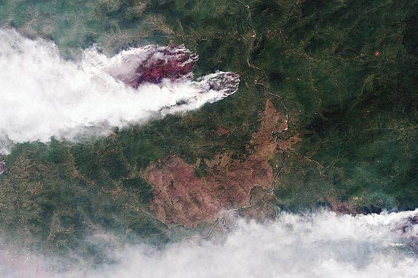 A satellite image of wildfires burning in Yakutia in Russia's eastern Siberia yesterday, in this handout photograph made available by the Russian state corporation for space activities, Roscosmos. Wildfires in Siberia have spread over three million h