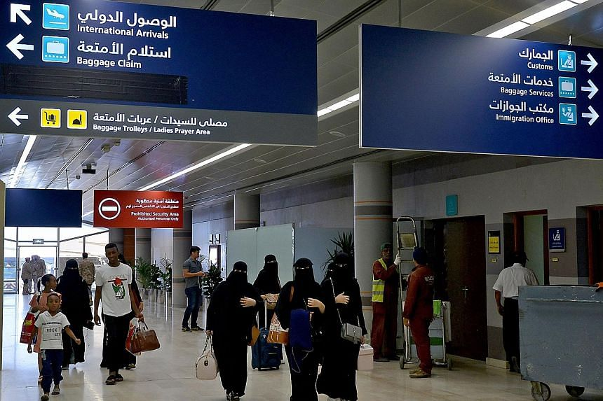 """Saudi women at the airport in Abha city in south-western Saudi Arabia. The country's landmark reform erodes the longstanding guardianship system that renders adult women as legal minors and lets their """"guardians"""" exercise arbitrary authority over the"""