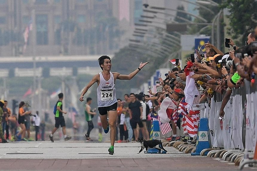 Singapore marathoner Soh Rui Yong sprinting to victory as he crosses the finish line in Putrajaya at the 2017 SEA Games to retain his title. ST FILE PHOTO