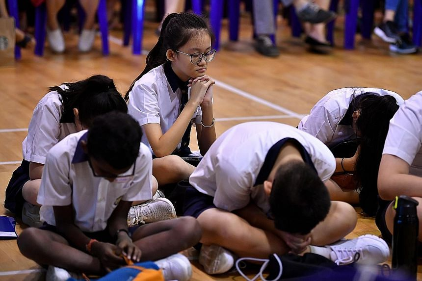 Pupils waiting for the release of their PSLE results last year. Parents have expressed concern over Foundation-level subjects under the new PSLE scoring system, but MOE has made it clear that while the 2021 scoring system is doing away with pinpoint