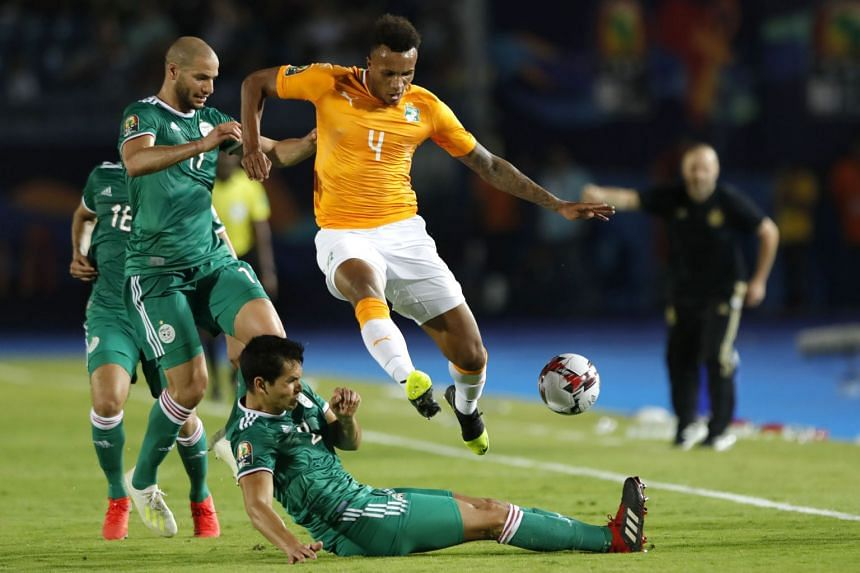 Gbamin (right) in action for Ivory Coast against Algeria in the 2019 Africa Cup of Nations.