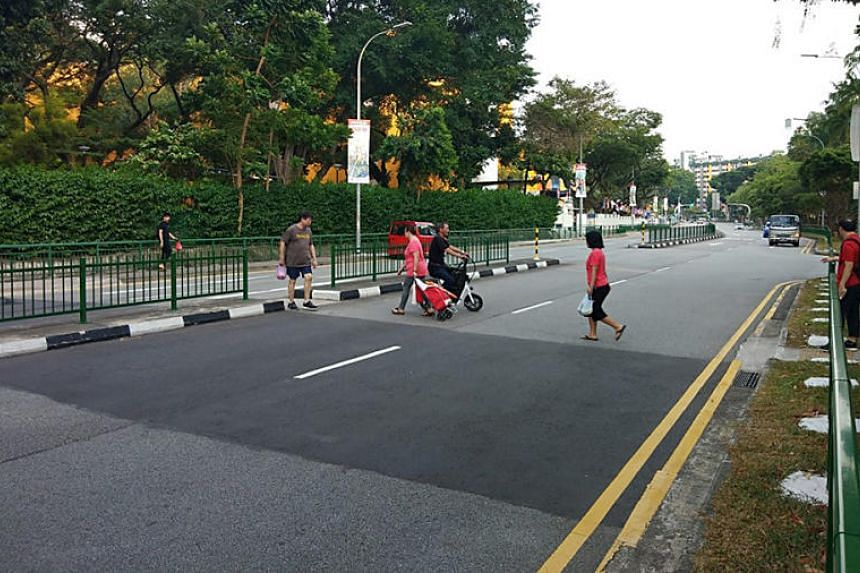 "Residents told Shin Min Daily News that many pedestrians use the ""gap"" in between railings to cross the road, especially to get to the bus stop."