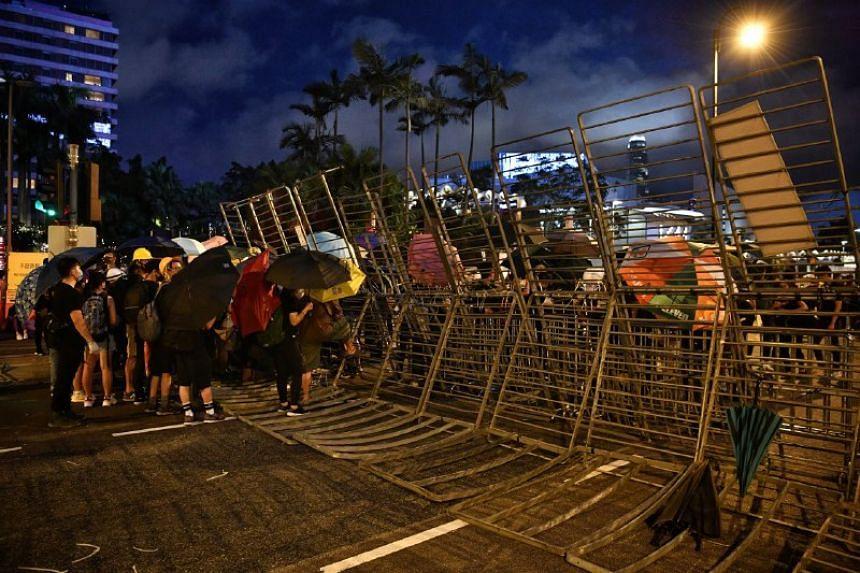 Protesters set up a roadblock outside InterContinental Hong Kong in Tsim Sha Tsui district on Aug 3, 2019.