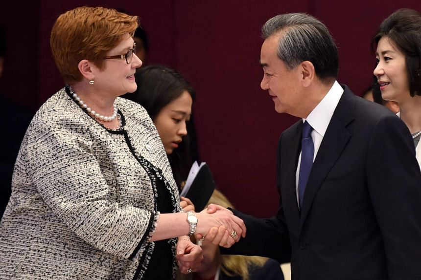 Australian Foreign Minister Marise Payne (left) meeting China's State Councillor Wang Yi on the sidelines of Asean talks in Bangkok.
