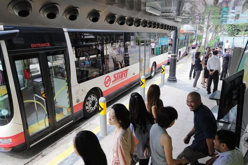 An SMRT bus waiting at a bus stop in Singapore.