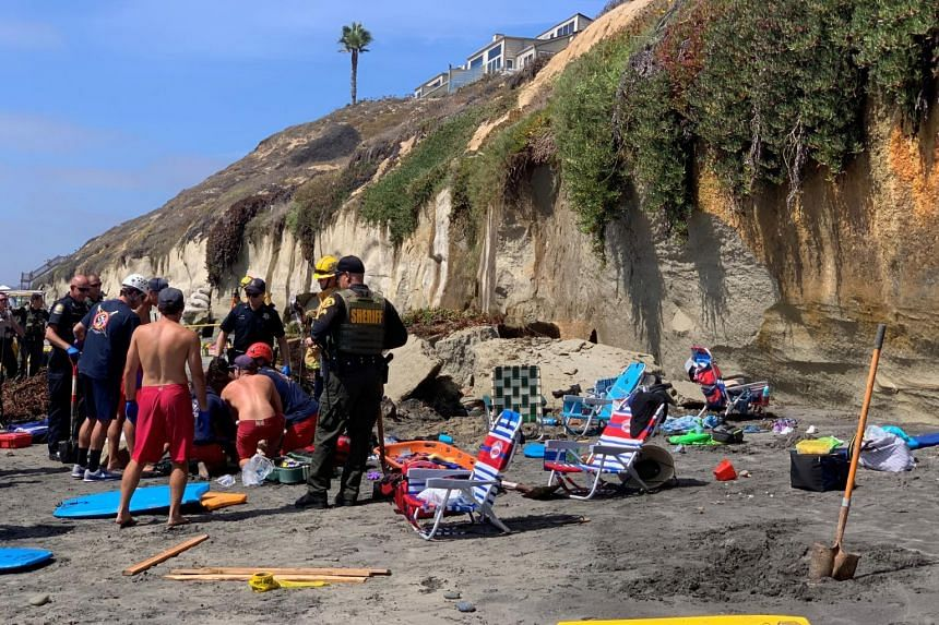 Emergency responders attend to a cliff collapse at a beach in Encinitas, California, on Aug 2, 2019.