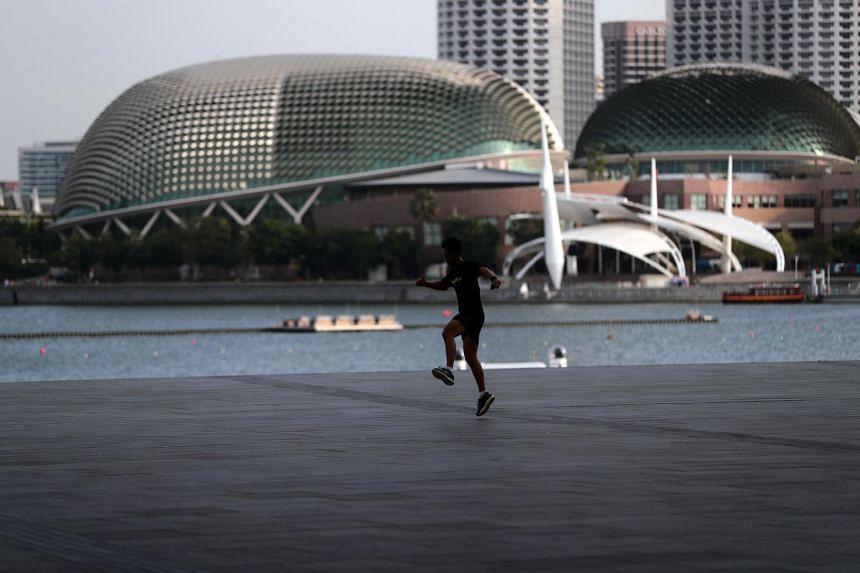 A man exercises along the Waterfront Promenade near Marina Bay Sands.