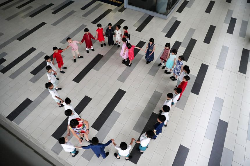 Students from Westwood Primary School celebrating Racial Harmony Day on 22 July 2019 with their friends and teachers.
