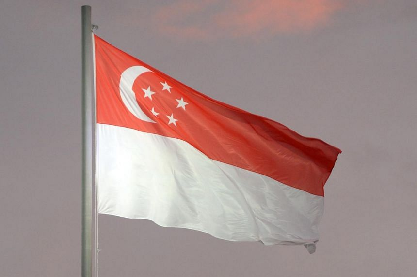 The Singapore flag flying in the wind.