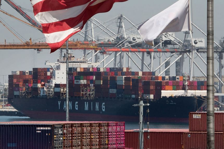 A container ship unloading its cargo from Asia at the Port of Long Beach, in California, on Thursday. With the next round of trade talks to be held next month in the US, Washington is essentially giving China one month to come up with concessions. Th