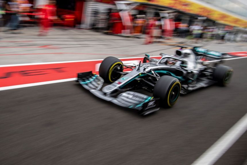 Mercedes' British driver Lewis Hamilton steers his car during the first practice session of the Hungarian grand prix.
