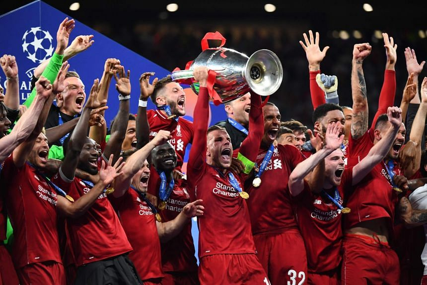 Liverpool players celebrate winning the Champions League in June 2019.