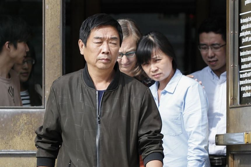 The victim's parents Ronggao Zhang (left) and Lifeng Ye (second right) leave court.