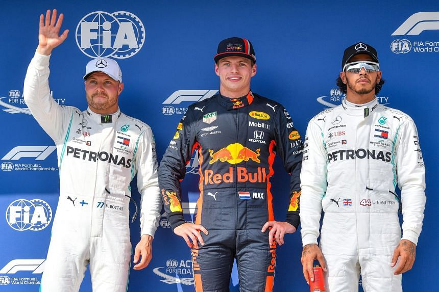 Verstappen (centre) after securing pole for the Hungarian grand prix with Bottas (left) and Hamilton.