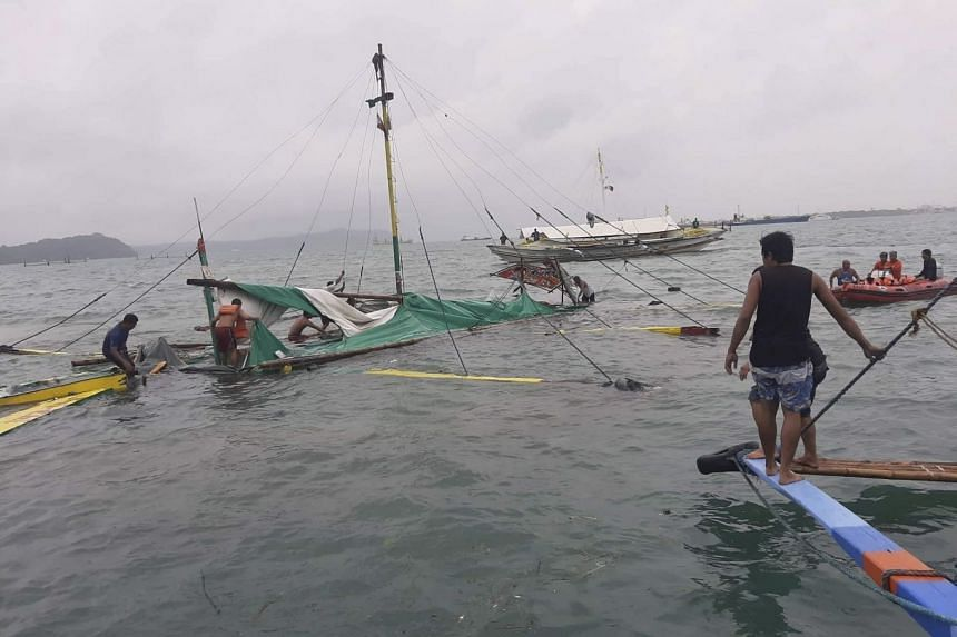 A capsized motorised boat in waters off the coasts of Iloilo City and Guimaras province.