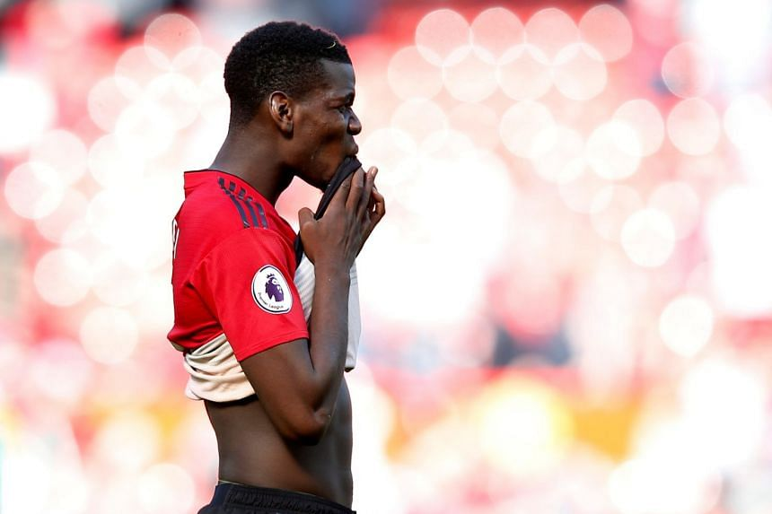 Pogba (above) was missing from the United squad for the pre-season penalty shootout win over AC Milan in Cardiff.