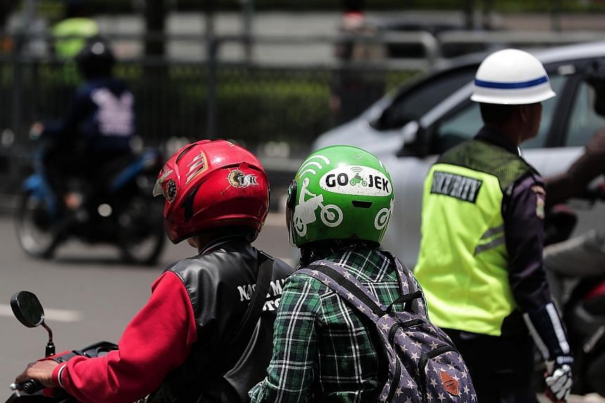 A Go-Jek customer taking a ride in Jakarta. With a young and growing population that is quick to adopt new technologies, South-east Asia's Internet economy is estimated to triple to more than US$240 billion by 2025.