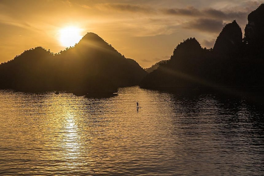 Paddleboarding at sunrise.