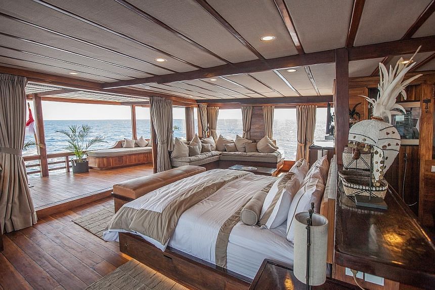 Get a massage aboard the Prana by Atzaro, a high-end phinisi liveaboard hand-built in ironwood and teak that sleeps 18 in nine sumptuous en-suite cabins (above).