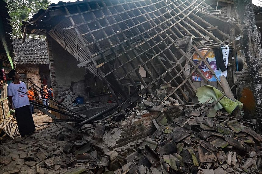 Another house in Pandeglang (below) that was damaged by the quake. At least 223 houses were destroyed.
