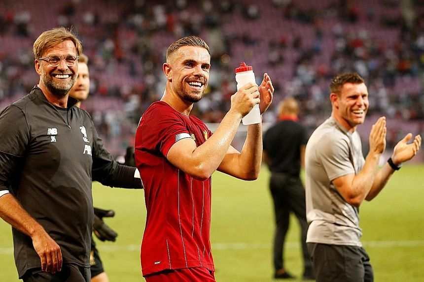(From left) Liverpool manager Jurgen Klopp, captain Jordan Henderson and vice-captain James Milner after rounding off their pre-season with a 3-1 win over French side Lyon in Geneva.