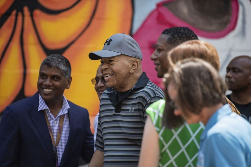 Cummings greets people after speaking at the opening of a park in Baltimore.