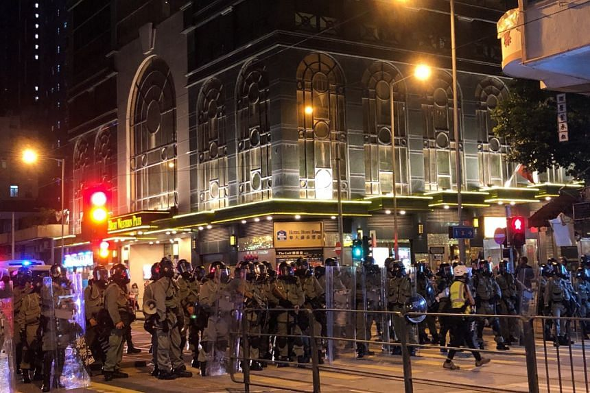 Riot police deployed to the Sai Ying Pun district in anticipation of clashes with protesters, on Aug 4, 2019.