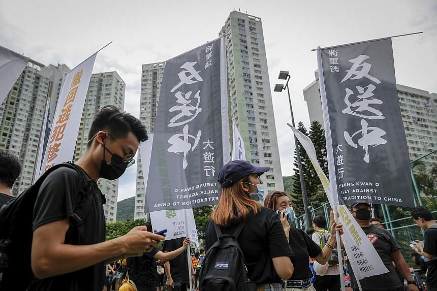 Protesters carrying anti-extradition Bill banners during a rally at Tseung Kwan O on Aug 4, 2019.