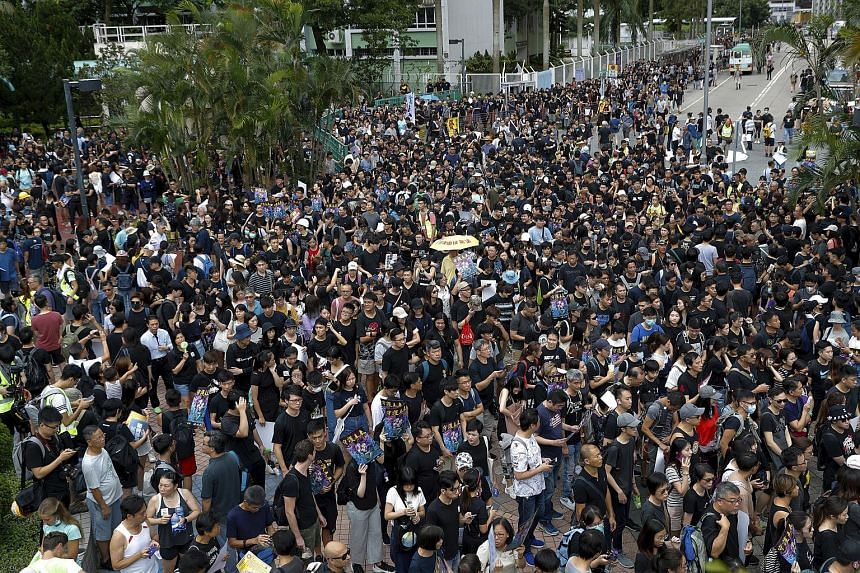Protesters gathering at Po Tsui park as they prepare to take part in a protest march in Hong Kong on Aug 4, 2019.